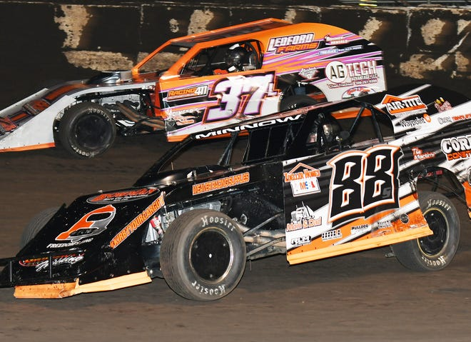 Michael Ledford (37) works his way past Alan Stipp early in the 25-lap modified feature Monday night at Fairbury Speedway. Ledford went on to win the $2,000-to-win race while Stipp took fourth.