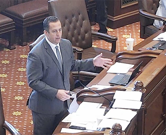 State Sen. Michael Hastings, D-Frankfort, speaks on the Senate floor Monday in support of an energy regulation overhaul bill. The measure, which aims to put Illinois on a path to 100 percent carbon-free energy by 2050, passed the chamber and will head to the governor.