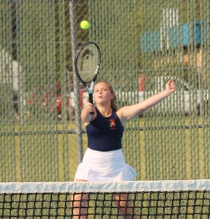 Brooke Burger lunges to return the ball during her singles match Monday. Burger won this match and teamed with Julie Branz to win in doubles as the Indians defeated Watseka.