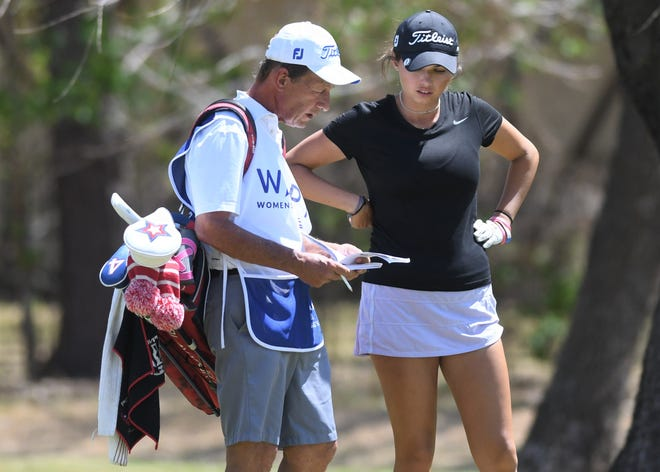 Alexa Pano talks to her dad, Rick, who was her caddie during the third round of the Mackie Construction Professional Golf Classic last April.
