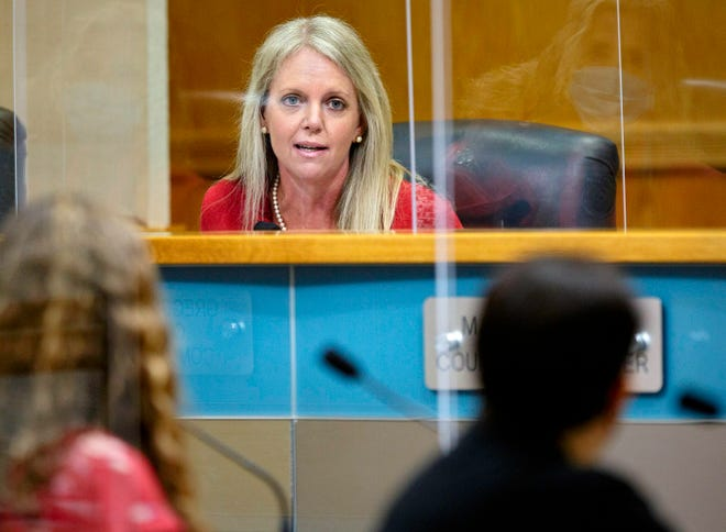 Palm Beach County commissioner Melissa McKinlay? quizzes Palm Beach County Health Director Dr. Alina Alonso about the comparison of vaccines and monoclonal antibody treatments during the commission meeting in West Palm Beach Tuesday, Sept. 14, 2021.
