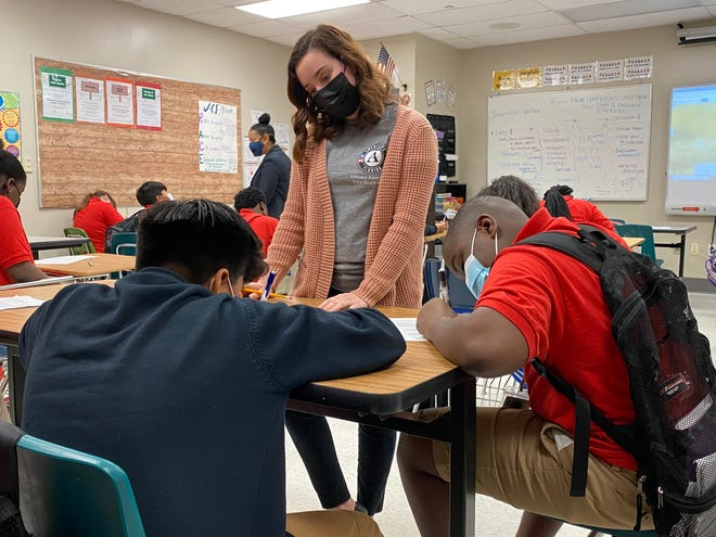 Literacy AmeriCorps member Sydney Bowman works with middle-school students at South Tech Prep in Boynton Beach.