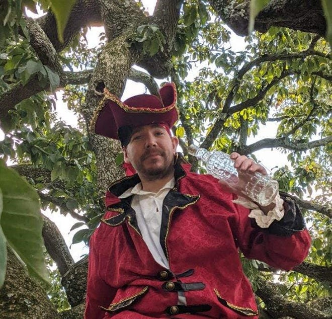 Kent Scudder of Prince George portrays a pirate in the famous Cucumber tree at Violet Bank Museum in Colonial Heights on Sept. 3, 2021.