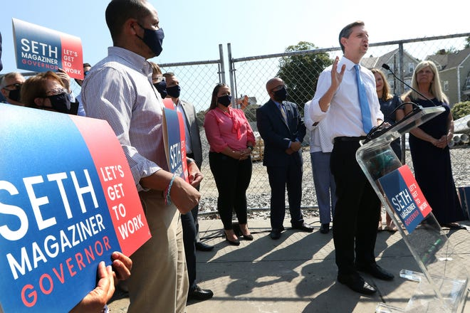 State Treasurer Seth Magaziner announces his candidacy for governor of Rhode Island outside the Winters Elementary School in Pawtucket.