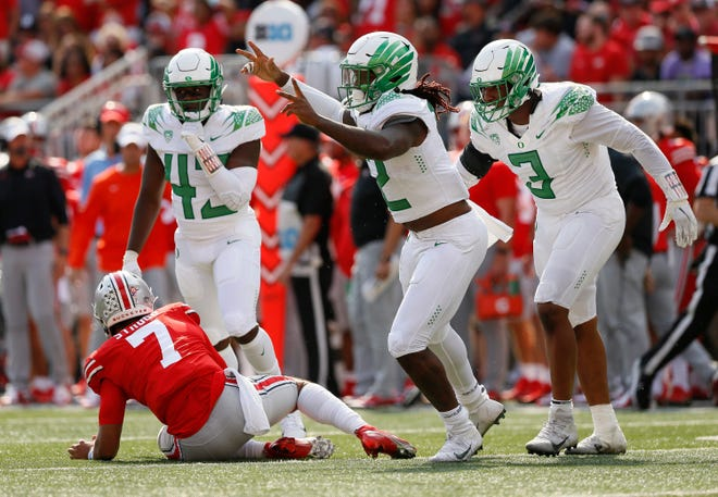 Oregon defensive end DJ Johnson celebrates a sack of Ohio State quarterback C.J. Stroud to end the game on Saturday. The Buckeyes had the ball twice in the fourth quarter while trailing by seven points and couldn't score.
