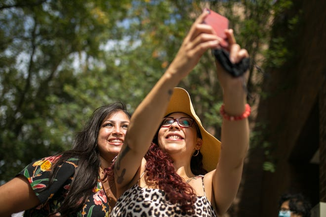 Hispanic chamber president Sully Cadengo, left, and artist and stylist Melissa Santillan take a selfie together during the Rockford Regional Hispanic Chamber of Commerce's grand opening on Tuesday, Sept. 14, 2021, at Regency Plaza Business Center in Rockford.