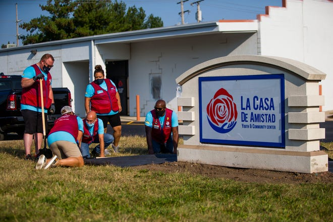 Volunteers help with landscaping Sept. 14 at La Casa de Amistad's new community center in South Bend.