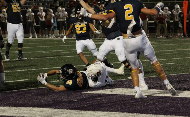 Stephenville's No. 88 Kallan Kimbrough grabs a pass from quarterback Ryder Lambert for a touchdown in the first half of their game against Salado on Friday at Tarleton's Memorial Stadium. The Jackets won, 48-21.