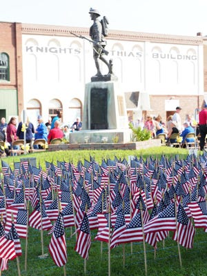 A tremendous crowd was on hand Saturday for the 'We Remember' event to honor victims of 9/11 and our very own fallen solider, Brett Wood, who lost his life ten years ago this month. One flag for each life lost adorned the courthouse lawn.
