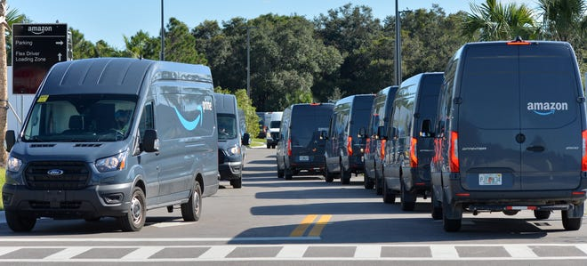 Delivery trucks line up outside the Amazon distribution center on Commerce Drive in Venice. The company announced on Tuesday that it plans to hire 8,000 people in Florida.