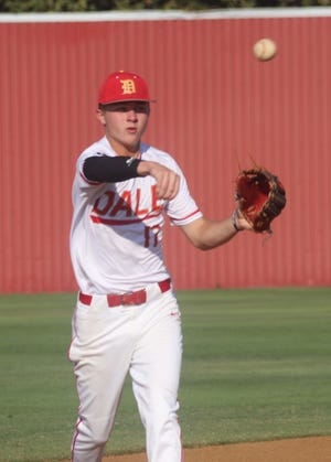Dale shortstop Dayton Forsythe fires the ball over to third base after fielding a grounder Monday at Dale.