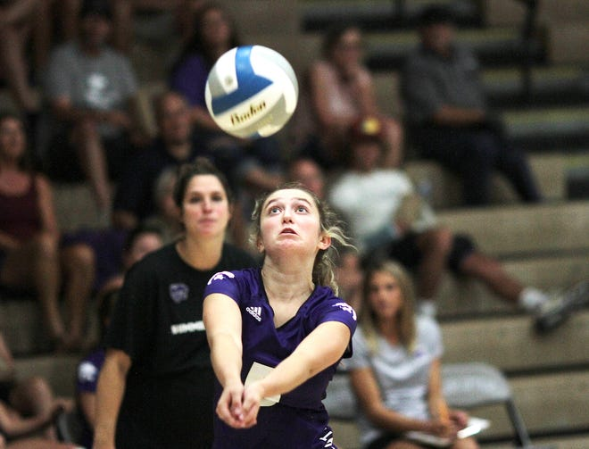 Payge Ellifritz runs down a loose ball before sending it back across the net in prep volleyball action on Monday.