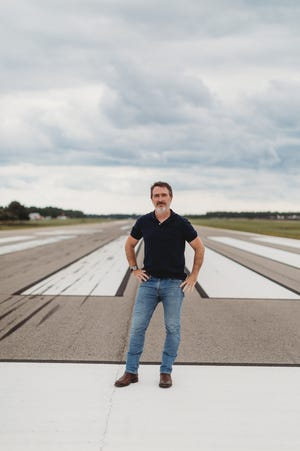 """Wilmington-based writer Wiley Cash at the Cape Fear Regional Jetport in Oak Island, which plays a big part in his fourth novel, """"When Ghosts Come Home."""" The character-driven mystery comes out Sept. 21."""