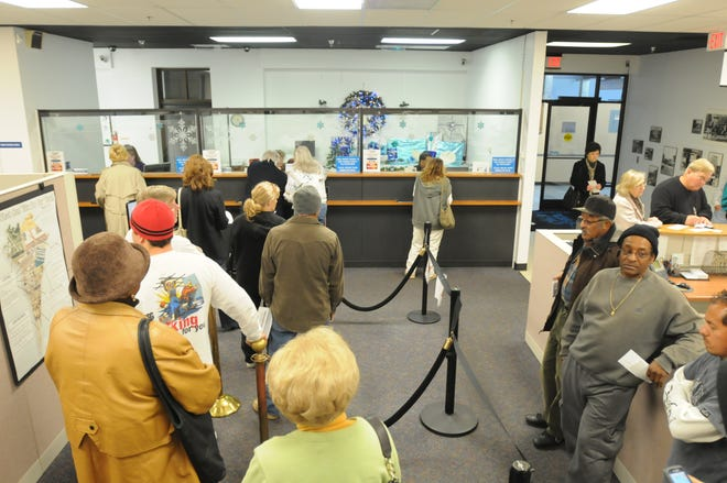 A line forms at the New Hanover County Tax Department as the deadline to pay property taxes approaches Wednesday, Jan. 4, 2012.