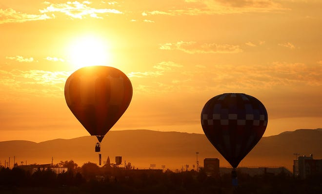 Balloons take flight during a mass ascension on media day for the 2021 Great Reno Balloon Race on Sept. 9 in Nevada.