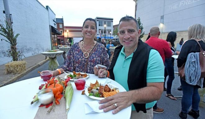 Diane and Tip Torres enjoy some of the cuisine at the 2018 Fall Fest block party.