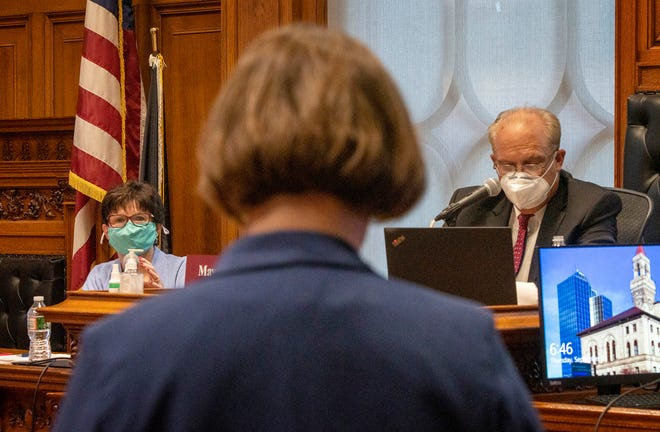 During a School Committee meeting on Sept. 2, Superintendent Maureen Binienda, left, and Mayor Joseph M. Petty, right, listen to committee member Tracy O'Connell Novick.
