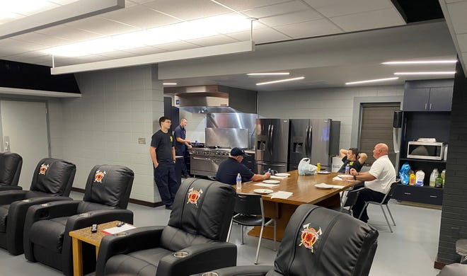 Firefighters at Fire Station 1 in the newly renovated living area. Crews moved back into their regular spaces July 16 after major renovations were completed because of mold found last September.