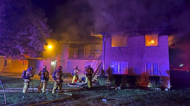 Firefighters on Monday night battle a fire at a two-story apartment complex on Yucca Loma Road south of Highway 18 in Apple Valley.