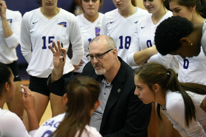 SAGU head volleyball coach Hank Moore huddles his players during recent action. The Lions improved to 4-0 in Sooner Athletic Conference play and 10-3 overall with three road wins over the weekend.