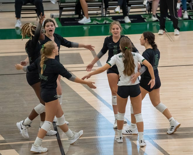 Waxahachie volleyball players celebrate a win against Waco High on Friday in their first District 11-6A match of the season. The Lady Indians won in straight sets, 25-5, 25-10, 25-8.