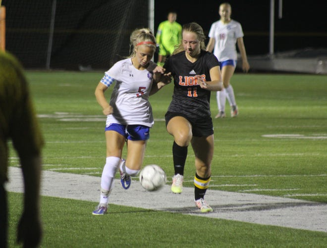 Hornell senior Ayla Prior (5) battles for control of the ball with Wellsville's Jaylynn Mess Monday night in Wellsville.