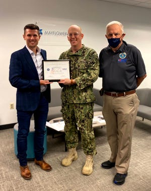 Employer Support of the Guard and Reserve announcedthat Cambridge resident Michael Brown was honored with a Patriot Award. Pictured, from left: Brown; Daniel Hubbard, lieutenant commander (sel.), U.S. Coast Guard (Reserve), and general counsel, Mayflower Wind; and John Pelose, Massachusetts ESGR.