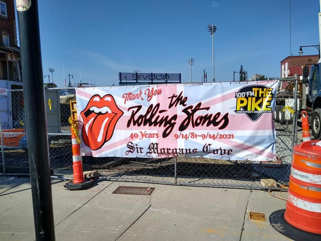 A banner commemorating the 40th anniversary of the Rolling Stones playing Worcester adorns a fence in front of the construction site next to the vacant husk of Sir Morgan's Cove.