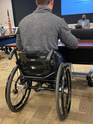 A picture taken by Democratic 11th District candidate Jay Carey shows Rep. Madison Cawthorn with what Carey said is a knife under his wheelchair at a Sept. 14 Henderson County School Board meeting