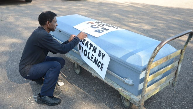 Bobby Holley plans to be in the streets of Battle Creek Thursday and Saturday with a casket to protest gun violence. Holley attached signs to the casket during a similar protest in 2018.