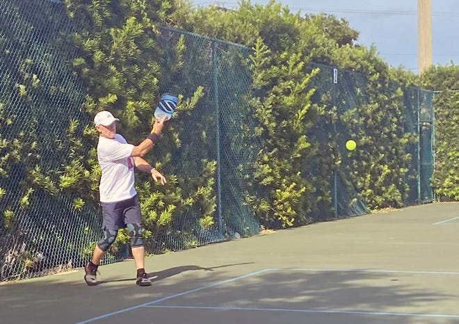 Tony Sonsini returns the ball during a pickleball game at the City of Cape Canaveral's sports complex.