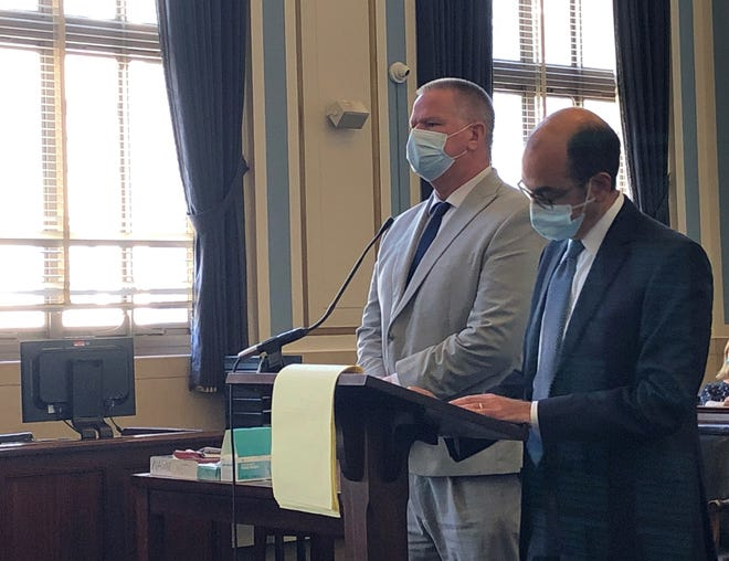 Kenneth Hackett stands to the left of his attorney, Edward Perry, at his sentencing in Hamilton County Common Pleas Court on Tuesday, Sept. 14, 2021.