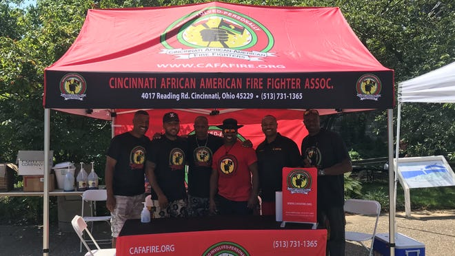 The Cincinnati African American Firefighter Association booth is pictured here at the Black Family Reunion. The firefighters work with the city health department to promote COVID-19 vaccination. Pictured are: Greg Phelia, Damonte Brown, Darrell Bullock, Keno Henry, William West III, and Duane Williams.