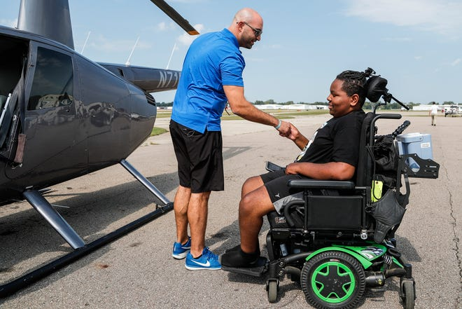 D-Man Foundation founder Ziad Kassab shakes hands with Torrance Johnson, 15, of Detroit, after Johnson's helicopter ride at Oakland County International Airport in Waterford Township on Sept. 14, 2021.