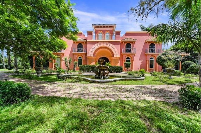 This house on 15.1 acres of land is surrounded by fruit trees, palm trees, bamboo and other greenery. Peacocks strut through the expansive gardens. The owner says there is no other place like this in Southwest Florida.
