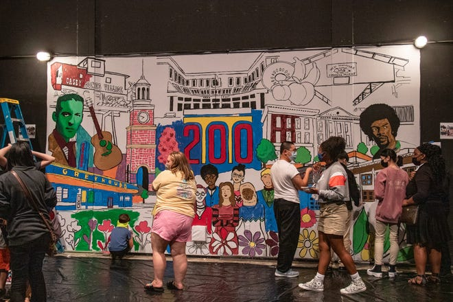 Children of all ages took part in painting the mural backstage at The Ned.