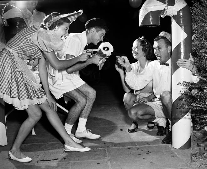 """July 25, 1952 -- William Hamilton """"Ham"""" Smythe III, second from left, performed at the Memphis Country Club during the Yuletide Revelers' informal party.  Alongside Smythe are Betty Nelson, left, Betty Janes and Kenneth Ruble."""