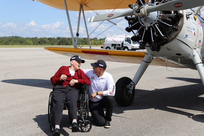 World War II Bombardier Robert Cwiak and pilot James Simms speak to each other in front of Dream Flights Boeing Stearman 75 aircraft. Cwiak flew onboard a B-24 Liberator out of Italy during World War II.