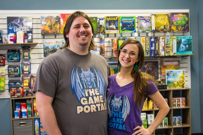 Brandon and Sarah Newman pose for a photo in The Game Portal. The couple purchased the gaming store in 2020.