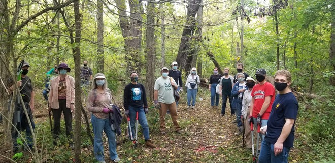 Volunteers post during a Red-tail Land Conservancy habitat restoration workday at Munsee Woods in 2020.