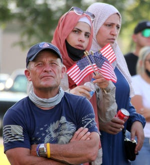 Citizens in the community came out on Saturday in support of the Luna County Teen Court's 9/11: Day of Remembrance program on the front lawn of the historic Luna County Courthouse.