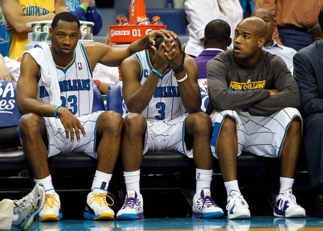 From left to right, New Orleans Hornets guards Willie Green, Chris Paul and Jarrett Jack react on the bench in the final moments of the second half of Game 6 of a first-round NBA basketball playoff series against the Los Angeles Lakers in New Orleans, Thursday, April 28, 2011. Los Angeles defeated New Orleans 98-80 to advance to the next round. (AP Photo/Patrick Semansky)