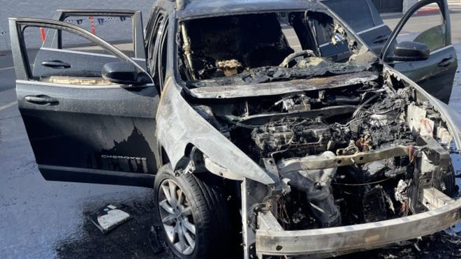 The remains of Nikki Smith's dream car after it exploded at a Phoenix Walmart after a routine oil change on August 29.