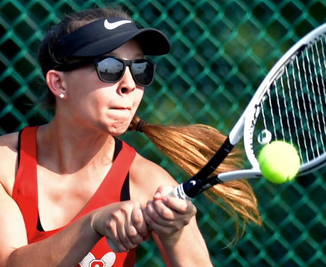 Susquehannock's Alli Zapach returns against Kennard-Dale's Grace Maccarelli in their second-seeded match during tennis action at Susquehannock Monday, Sept. 13, 2021. Bill Kalina photo