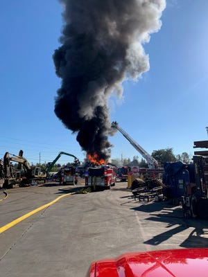 Salem firefighters are battling a blaze at Cherry City Metals in northeast Salem after a metal pile caught fire.