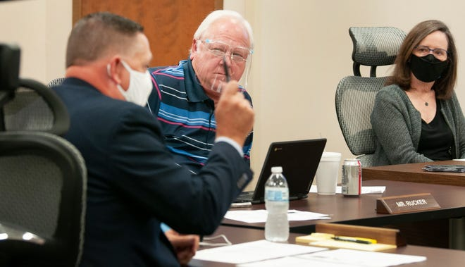 School board president Mike Rucker listens as Supt. Michael Kuhrt lays out the problems facing Wichita Falls public schools.