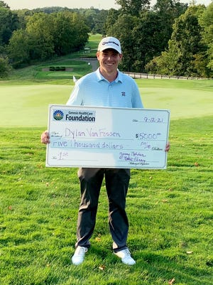 Norwich native Dylan Van Fossen poses with the winner's check after winning the annual Genesis Pro-Am on Sunday at Zanesville Country Club. Van Fossen shot 10-under-par 62 to break the course record, previously held by Bob Sowards, by one shot.