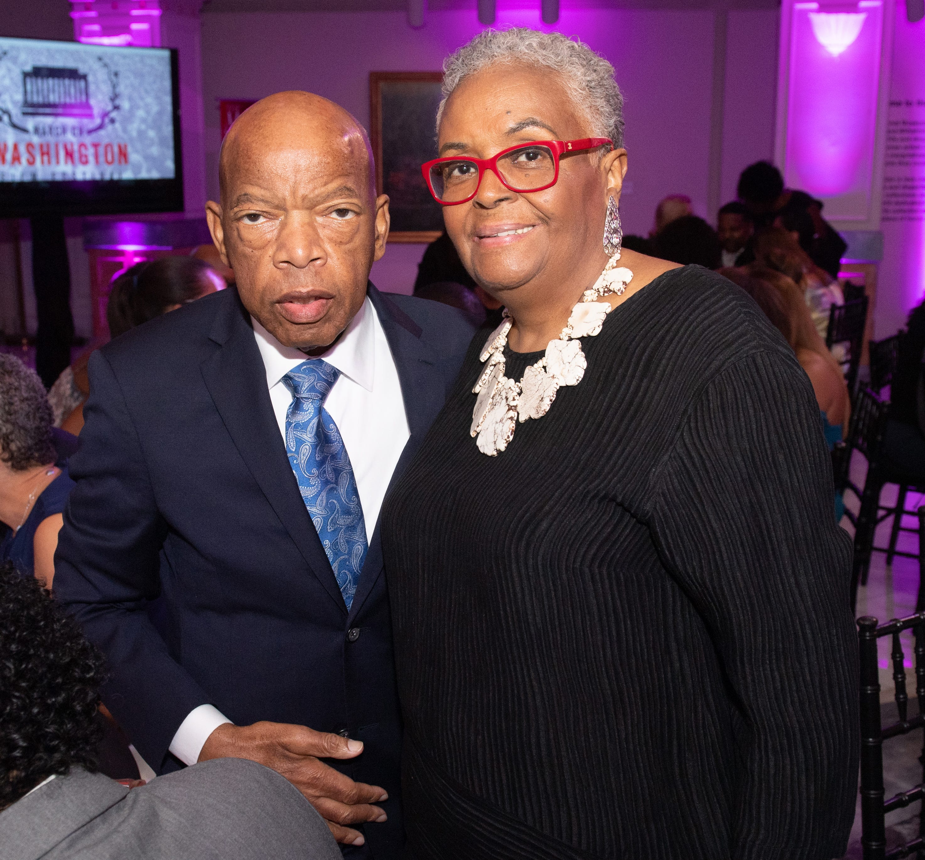 The late Georgia Rep. John Lewis and Joyce Ladner, both veterans of the civil rights movement chat in 2019 at a gala hosted by the March on Washington Film Festival.