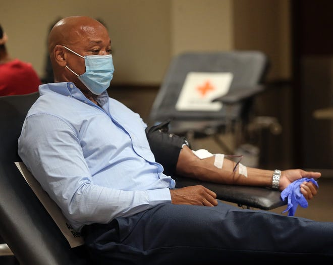 Franklin Myles of Hudson makes a donation Tuesday during a blood drive at the American Red Cross in Akron.
