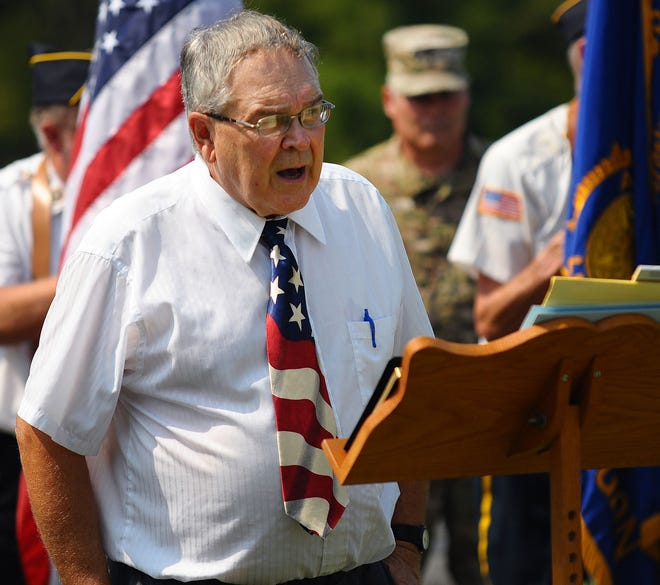 """Moderator Ken Bandy speaks Sunday, Sept. 12, 2021, during the """"Homecoming 21"""" event at North Georgetown Cemetery. The event was a commemoration of a ceremony that took place 100 years ago this month upon the return of remains of Pfc. John Berger, who was killed in World War I in France."""